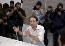 Iglesias, leader of Spain's Podemos (We Can) party, talks during a meeting with candidates for the upcoming regional elections in Madrid